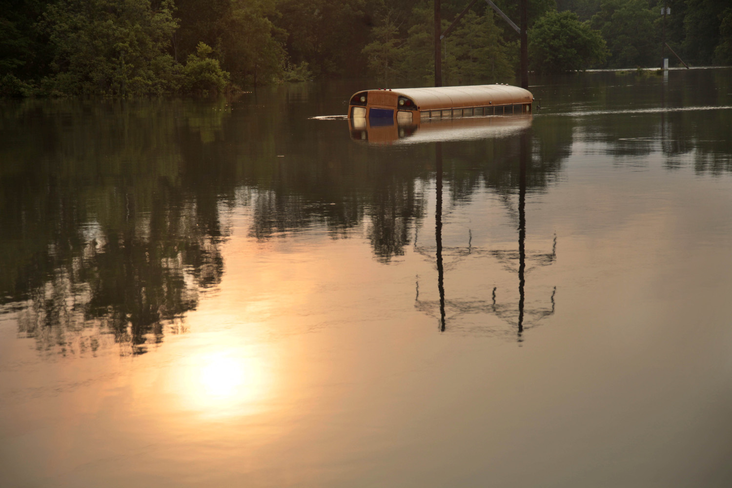 May 20, 2011. An old school bus sits in floodwaters from the rising Mississippi River in St. Francisville, Louisiana, where a dozen homes and businesses and several camps were flooded.
