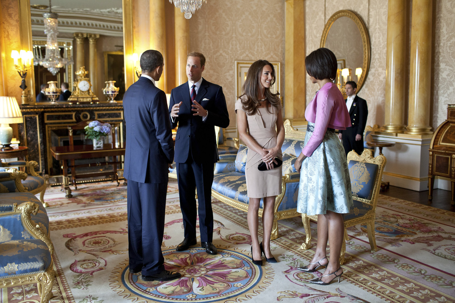 May 24, 2011. President Barack Obama and First Lady Michelle Obama talk with the Duke and Duchess of Cambridge in the 1844 Room at Buckingham Palace in London, England.