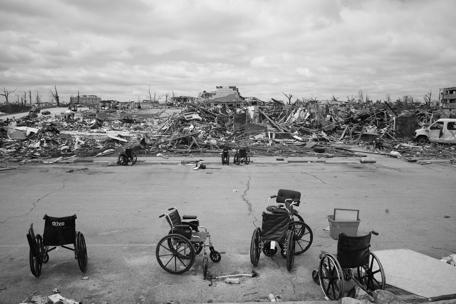May 27, 2011. Abandoned wheelchairs scattered in the parking lot at the devastated Greenbriar Nursing Home in Joplin, Mo. Eleven residents died after an EF-5 tornado struck the facility.