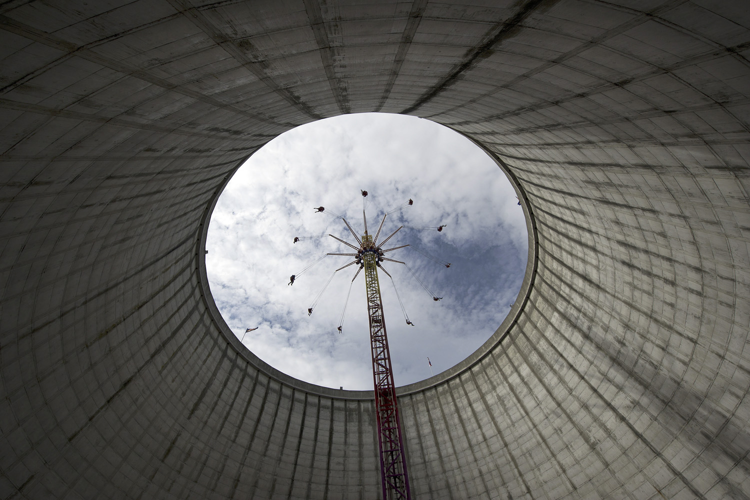 May 28, 2011. A merry-go-round turns inside of the cooling tower of the former nuclear power plant in Kalkar, western Germany, near the border with the Netherlands. The plant was constructed from 1977 to 1986, but never operated  as nuclear power plant. Today, the plant serves as a leisure fun park, welcoming some 600,000 visitors a year.