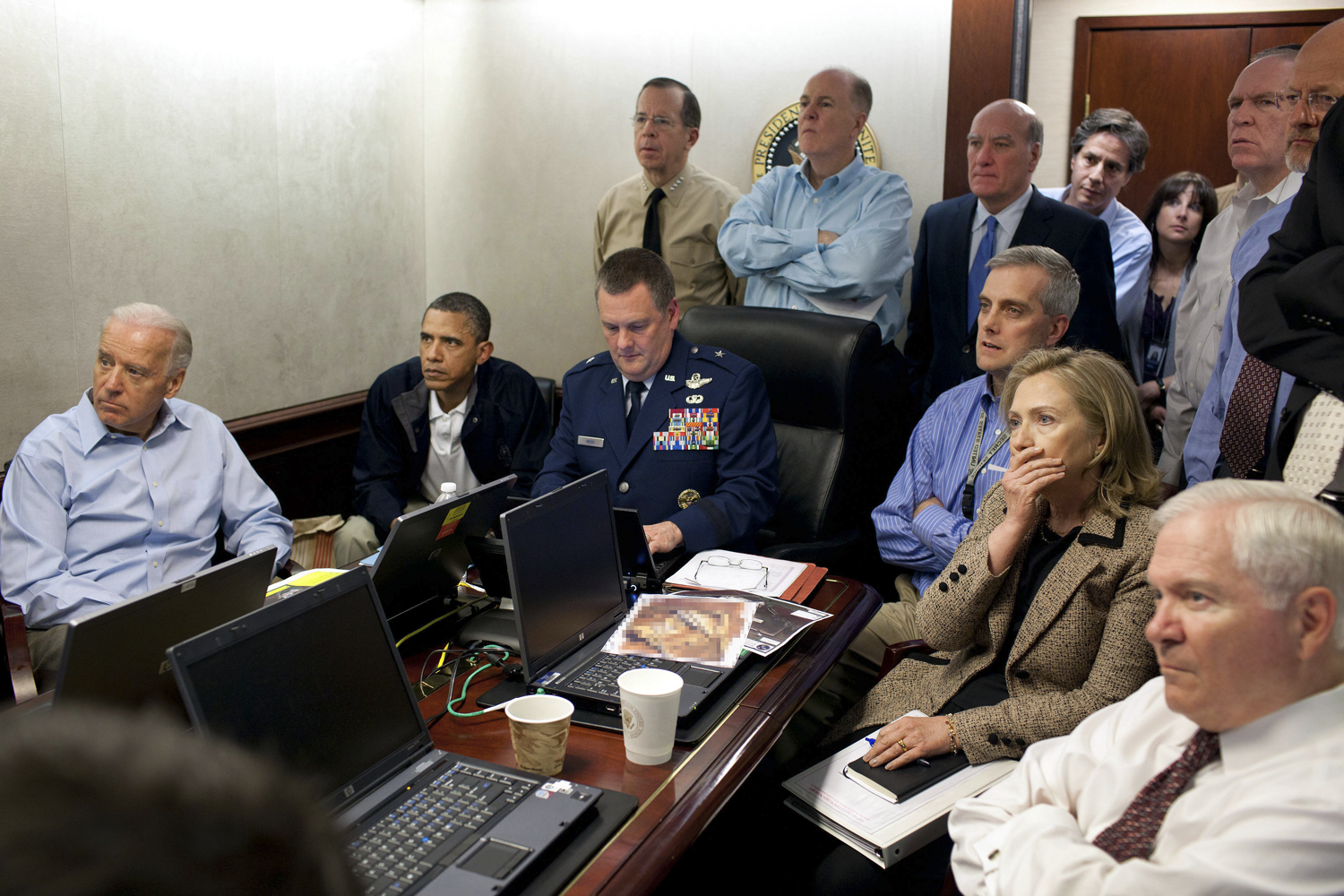 May 1, 2011. President Barack Obama and his national security team watch the Osama bin Laden mission in the White House Situation Room. Please note: a classified document seen in this photograph has been obscured.