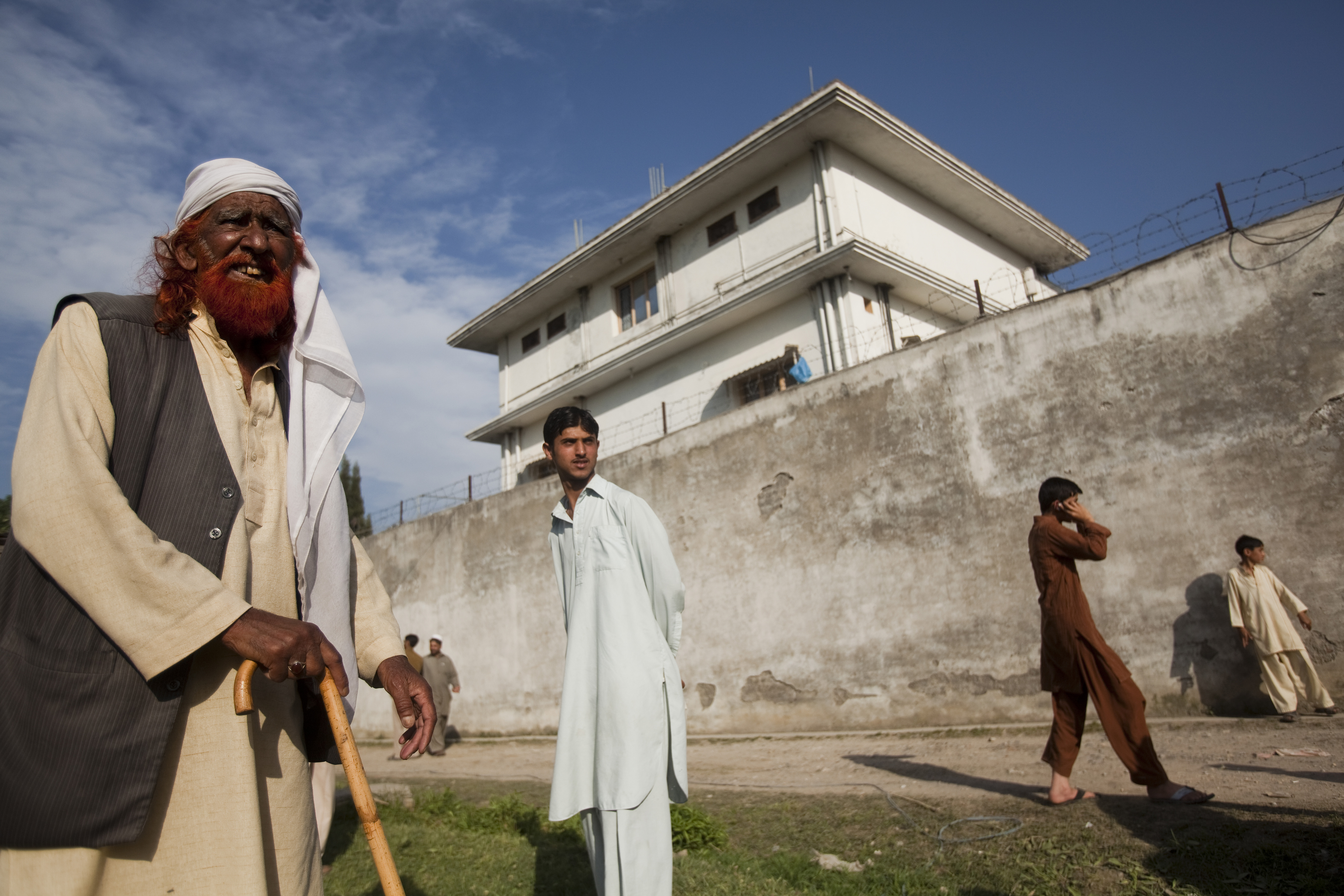 May 3, 2011. Locals gather outside the compound where Osama bin Laden was reportedly killed in an operation by U.S. Navy Seals in Abottabad, Pakistan.
