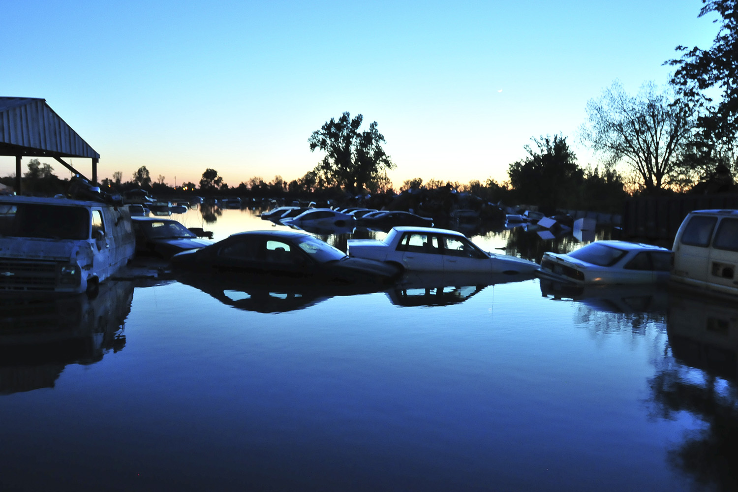 May 4, 2011. Cars are seen soaked in floods in the town of Cairo, Illinois after intense storms and record-breaking rains brought about heavy flooding in southern parts of the state.