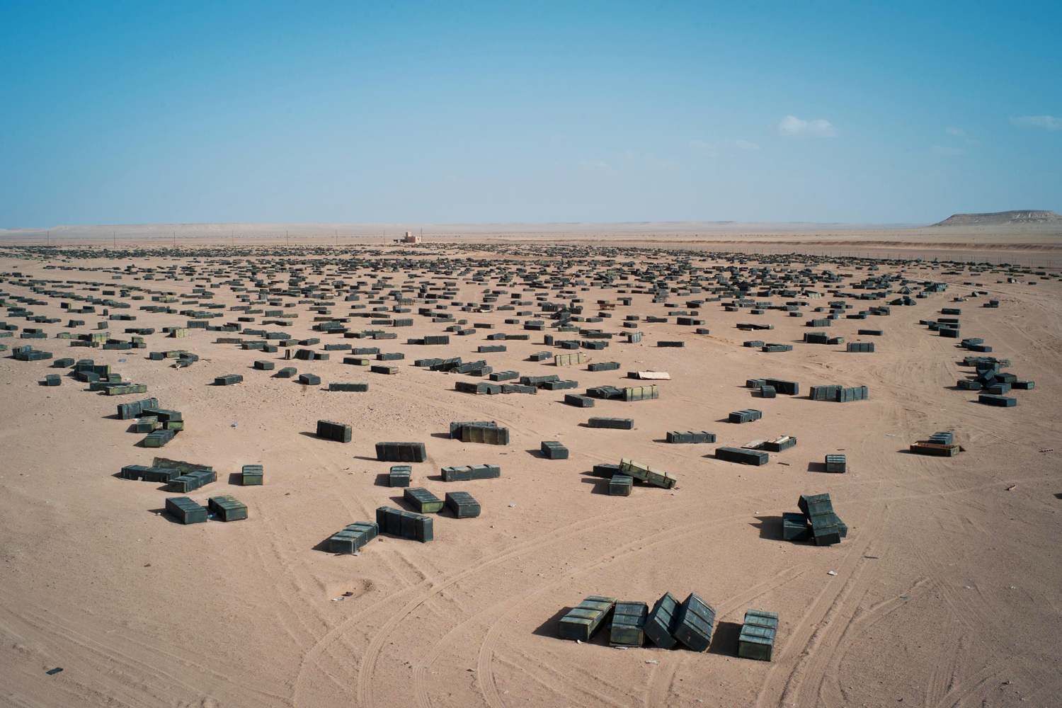 October 26, 2011. Munition crates are seen at an unguarded storage facility in the desert, some 62 miles (100 kilometers) south of Sirt, Libya.