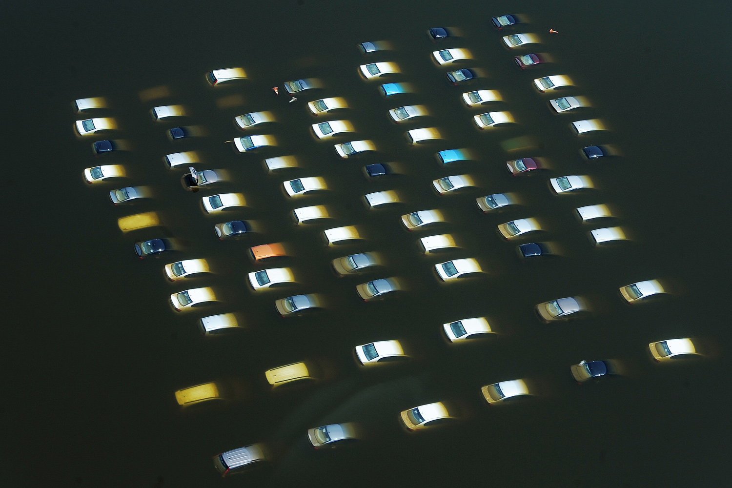 October 11, 2011. This file aerial picture shows cars submerged in floods waters at a Honda car factory outside the ancient Thai capital of Ayutthaya, north of Bangkok.
