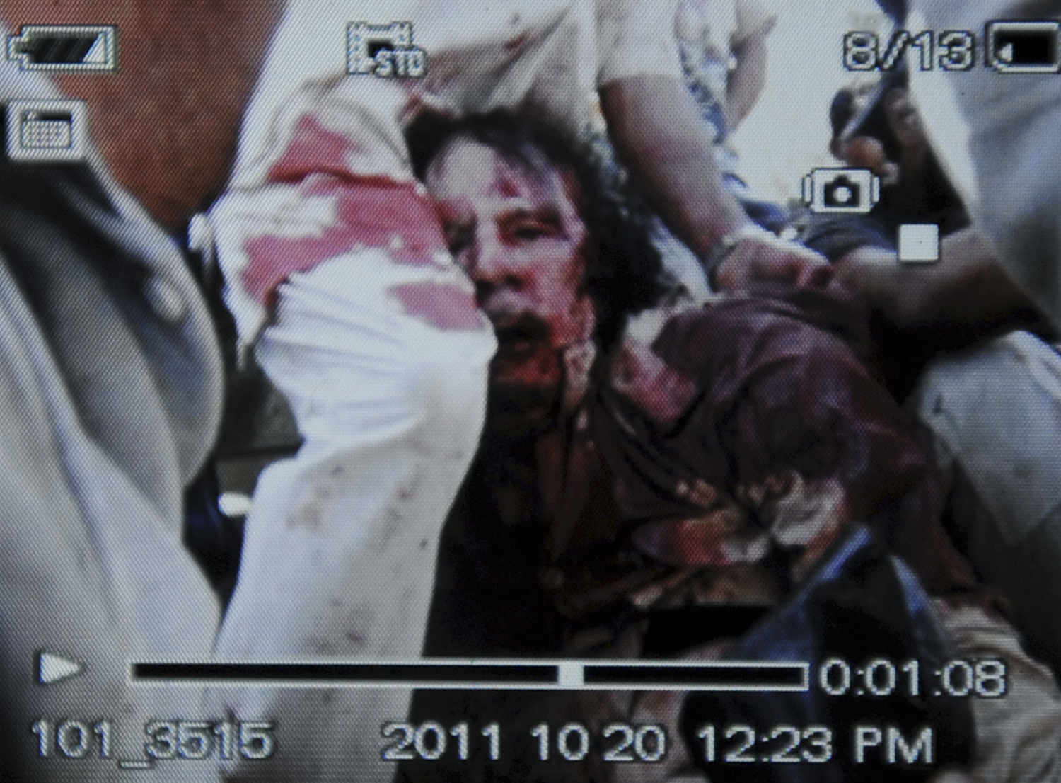 October 20, 2011. An image captured off a cellular phone camera shows the arrest of Libya's strongman Muammar Gaddafi in Sirt.