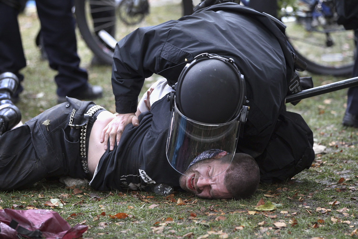 October 29, 2011. A policeman in riot gear arrests a protester at the  Occupy Denver  camp. Following a march by protesters, police tried to tear down some newly-errected tents at the encampment and scuffled with demonstrators.