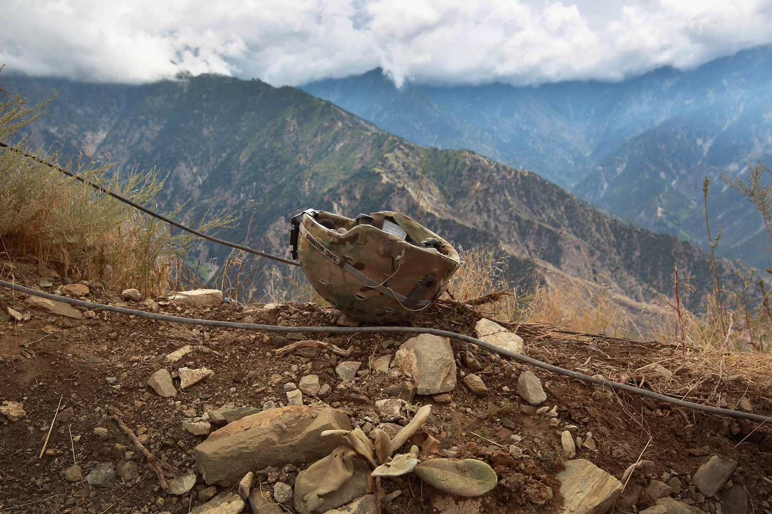 September 2, 2011. A U.S. soldier's helmet lies on a mountaintop position on at Observation Post Mustang in Kunar Province, Afghanistan. The area, in northeastern Afghanistan near the Pakistan border, is a major infiltration route by Taliban fighters coming across from Pakistan and has seen some of the heaviest fighting of the war.
