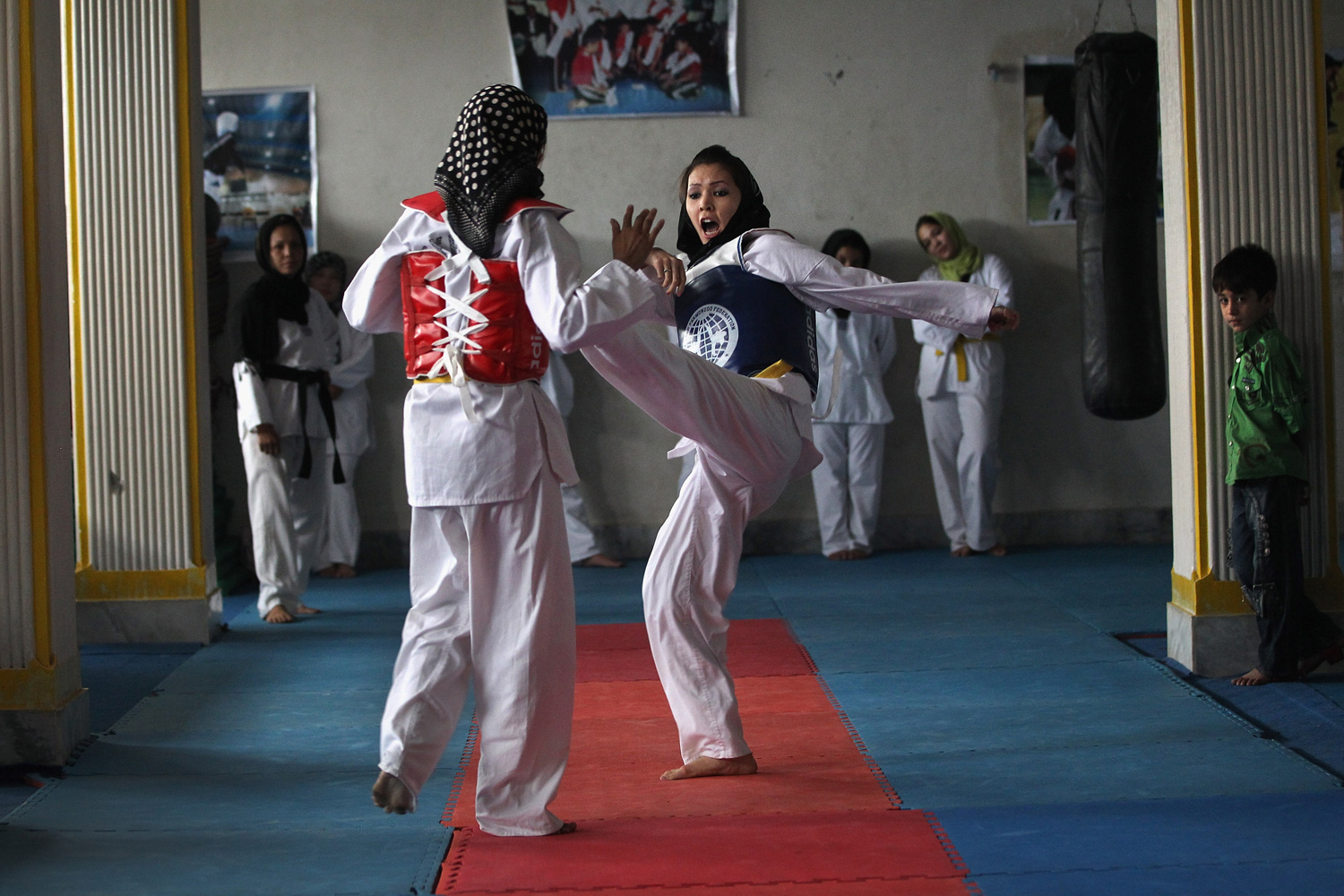September 7, 2011. Afghan girls practice martial arts at a U.S. funded gym for women in Kabul, Afghanistan. The facility, called the Alzahra Cultural and Sport Association, is the only gym for women in western Kabul and received almost $10,000 as startup money from the U.S. Ambassador's Small Grants Program (ASGP).