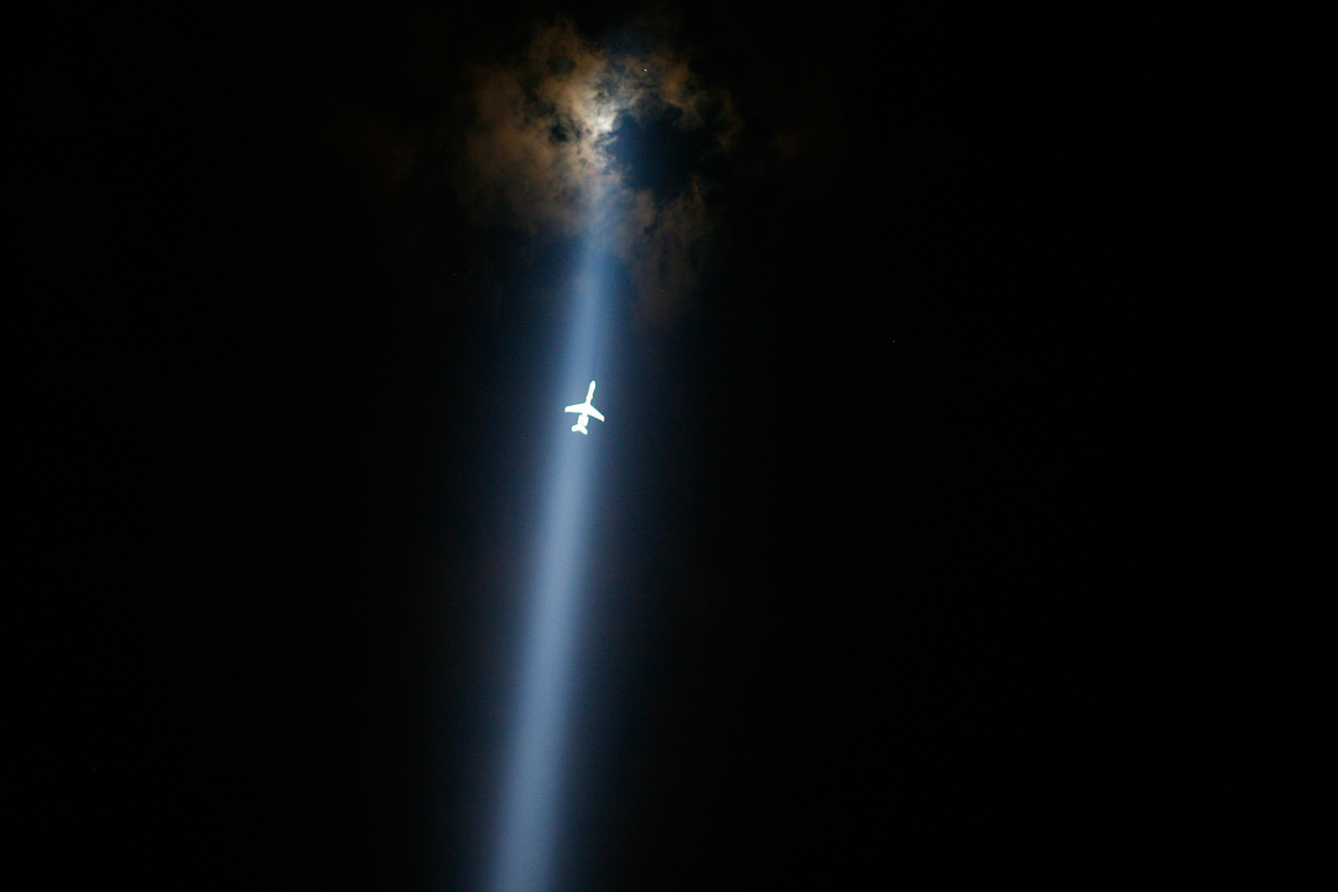 September 10, 2011. A plane flies through the  Tribute in Lights  in lower Manhattan in New York.