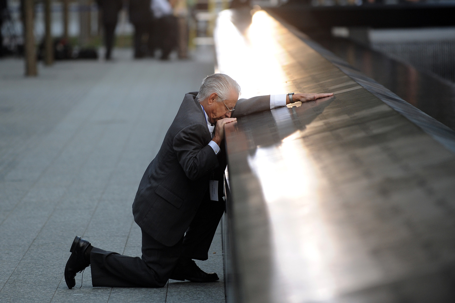 September 11, 2011.  Robert Peraza, who lost his son Robert David Peraza, pauses at his son's name at the North Pool of the 9/11 Memorial during tenth anniversary ceremonies at the site of the World Trade Center in New York City.