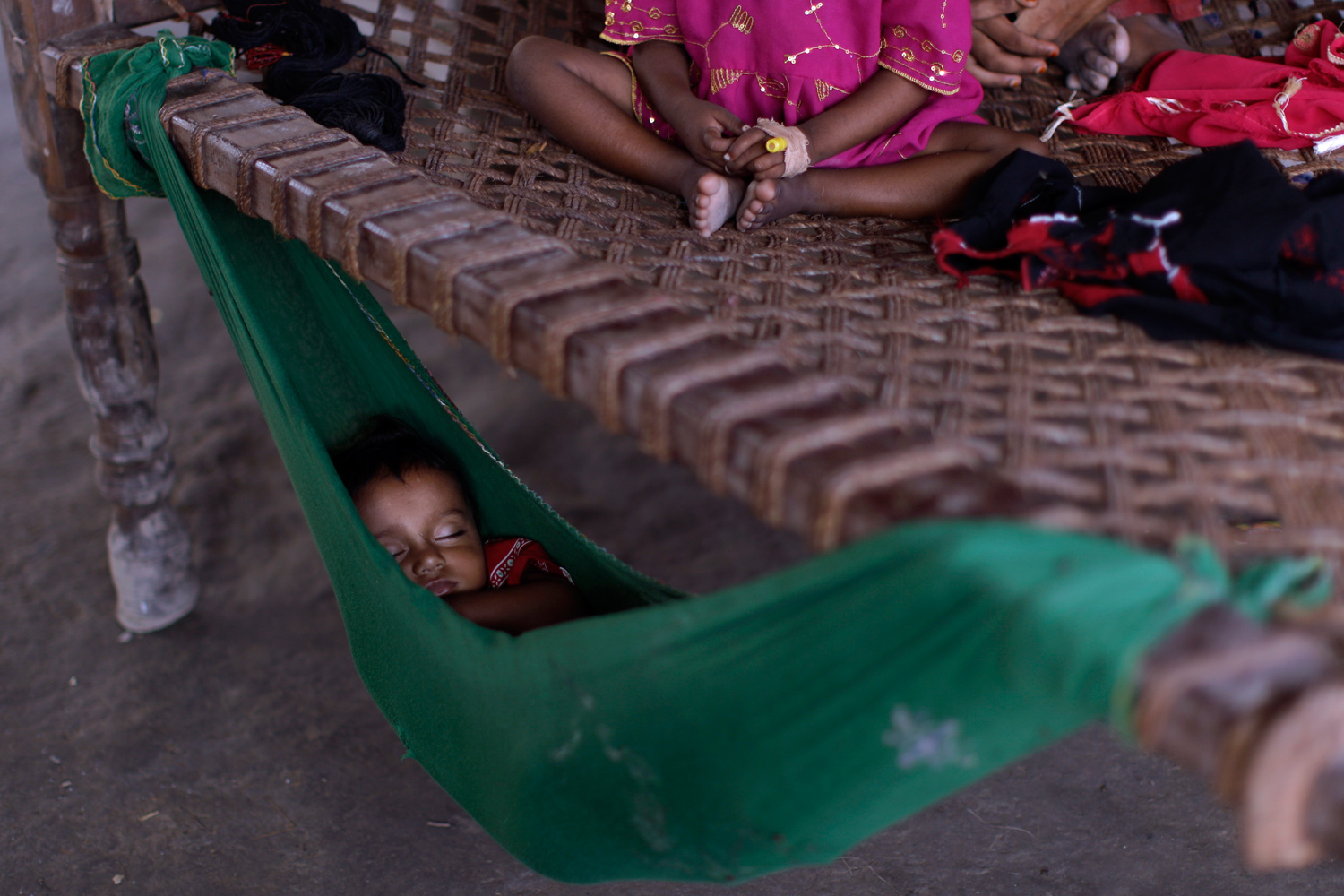 September 18, 2011. A Pakistani child displaced by floods sleep in a hammock at a shanty, in Badin district near Hyderabad, Pakistan.