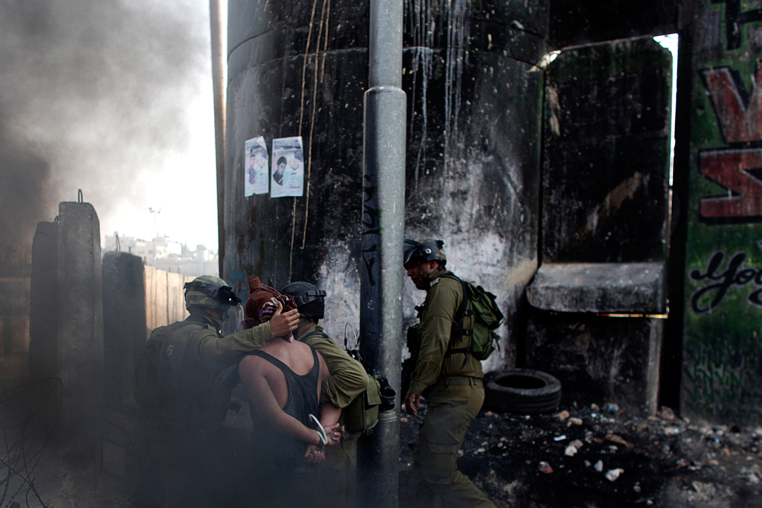 September 21, 2011. Israeli soldiers arrest a Palestinian demonstrator during clashes at the Qalandia checkpoint between the West Bank city of Ramallah and Jerusalem.
