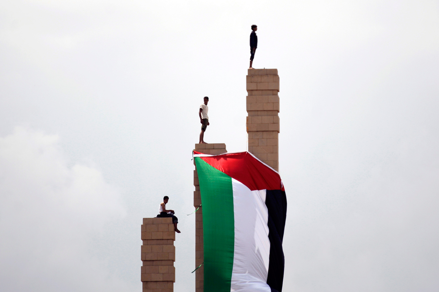 September 23, 2011. Supporters of Yemen's President Ali Abduallah Saleh gather at the Monument of the Unknown Soldier, where a Palestinian flag hangs during a rally celebrating his return to Sana'a, Yemen.