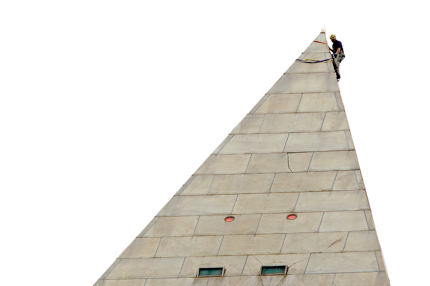 September 27, 2011. An engineer begins the process of conducting a block-by-block inspection of the exterior of the Washington Monument while suspended by ropes in Washington, DC.