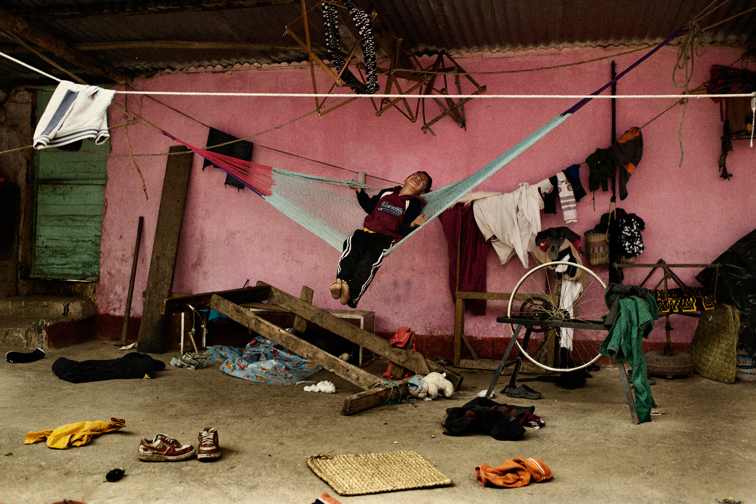 September 26, 2011. A kid playing with a hammock in Aldea Vasca, Guatemala.