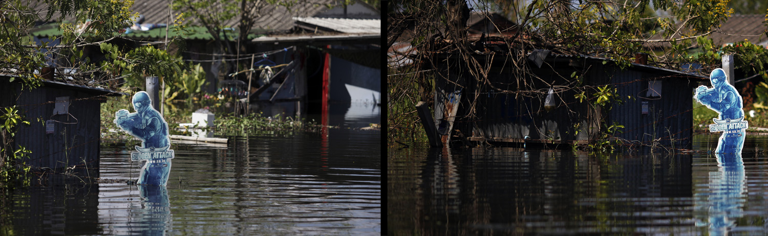 November 2, 2011. A cutout of an online game character stands amid floodwaters on the outskirts of Bangkok, Thailand.