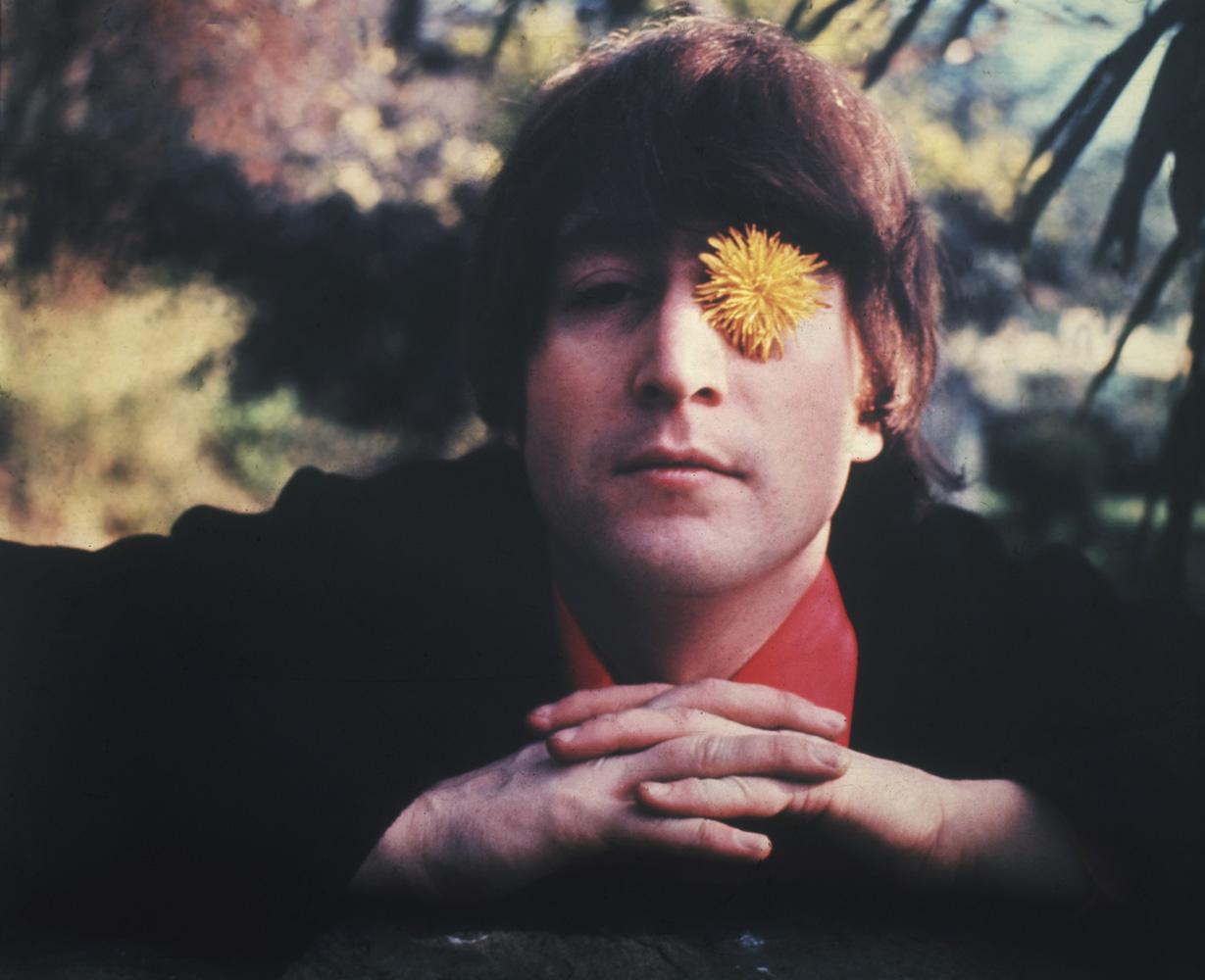 John Lennon in the garden in a photograph taken by Robert Whitaker in 1966.