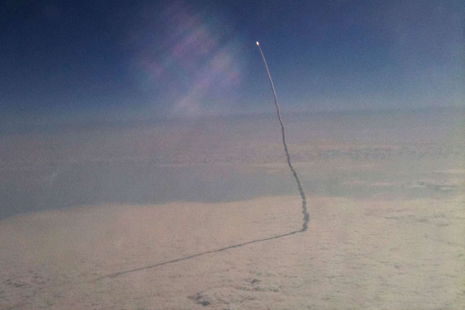 May 16, 2011. This citizen journalism photo taken with a cell phone by Stefanie Gordon aboard a passenger flight from New York to Palm Beach, Fla. shows the space shuttle Endeavor as it streaks toward orbit shortly after liftoff.