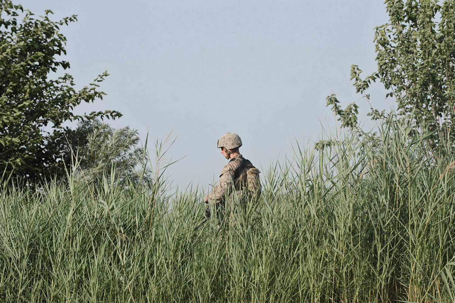 May 25, 2011. A U.S. Marine from 3rd Battalion 9th Marines Kodiak Company walks to his patrol base in Block 9th of Marjah district in Helmand Province, Afghanistan.