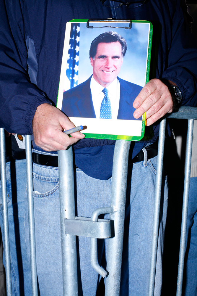 A man waits for a Romney autograph during a campaign event at Ring Power Lift Trucks in Jacksonville, Fla., January 30, 2012.