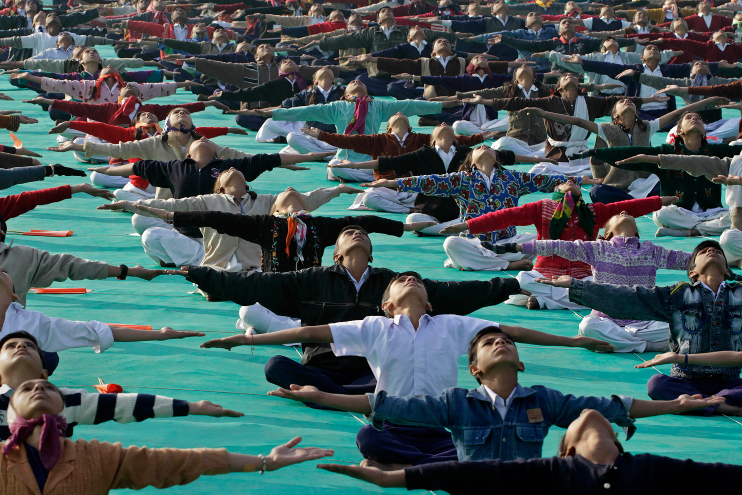 January 10, 2012. Indian school children perform yoga during a rehearsal for the inaugural ceremony of the International Kite Festival in Ahmadabad, India.