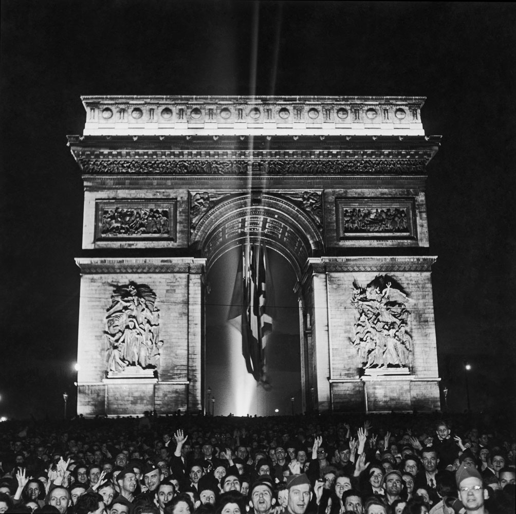 Thousands throng the Arc de Triomphe to celebrate the end of World War II in Europe, on May 8, 1945, in this famous Ralph Morse picture. Morse was back in the City of Light less than a year after chronicling Paris' liberation.