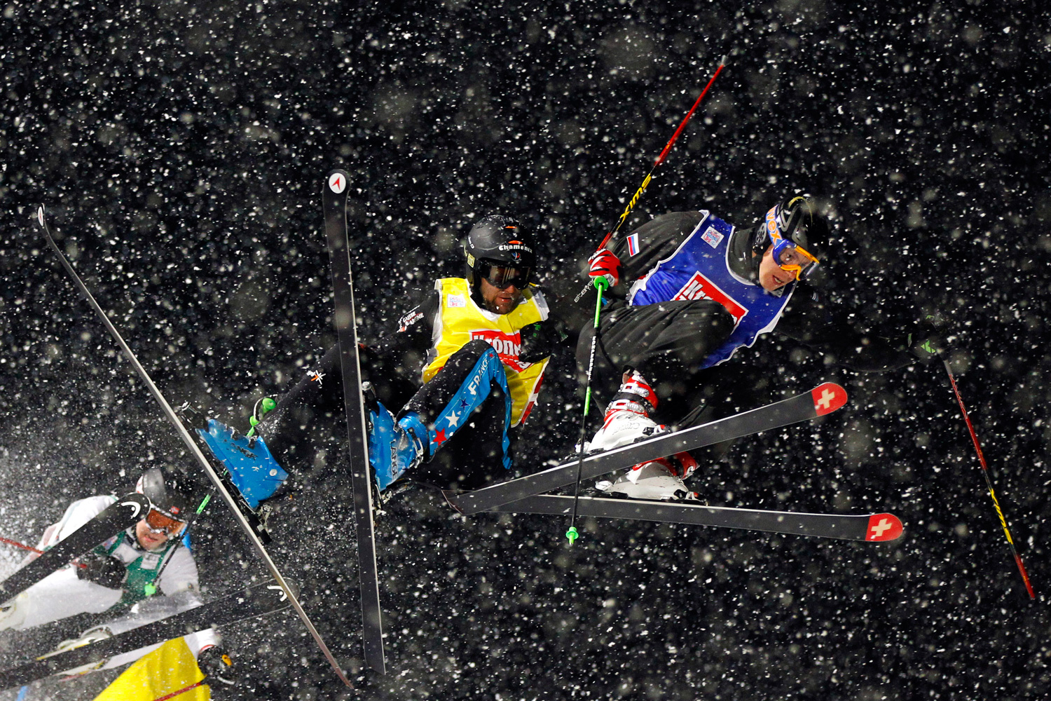 January 7, 2012. From left to right, Russia's Ivan Anikin, France's Jonas Devouassoux and Norway's Christian Mithassel ski down the slope during their run at the FIS skicross world cup event in Sankt Johann.