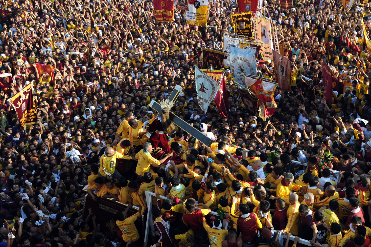 January 9, 2012. Philippine Catholic pilgrims carry the statue of the Black Nazarene, a life-size icon of Jesus Christ carrying a cross, to mark the annual day-long religious procession in Manila.