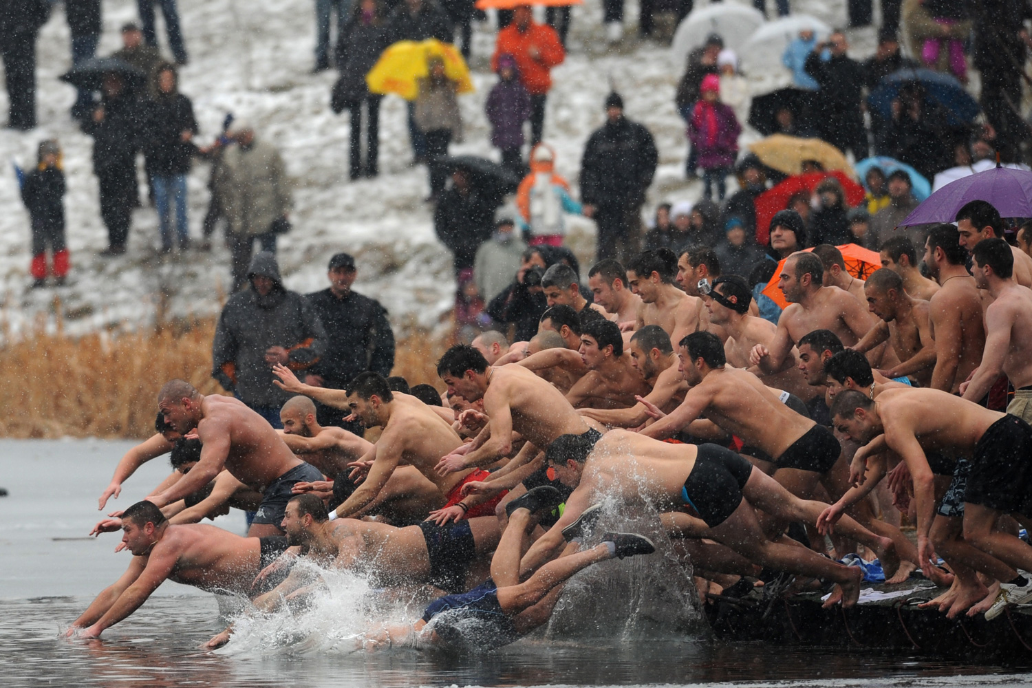 January 6, 2012. Bulgarians dive into icy water as they compete to catch a cross in the middle of a lake in Sofia as part of Epiphany Day celebrations. It is believed that the man who is the first to grab the cross, thrown into the water by an Eastern Orthodox priest, will be healthy throughout the year.