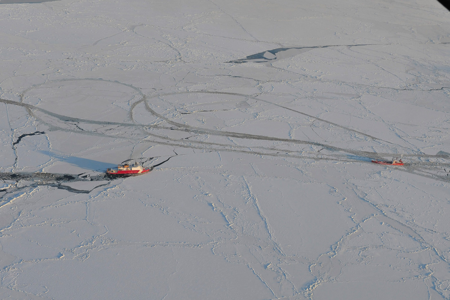 January 8, 2012. U.S. Coast Guard Cutter Healy breaks through the Bering Sea ice, 266 km (165 miles) south of Nome, Alaska, on a return path to break ice up around the Russian-flagged tanker Renda. The Seattle-based Healy is escorting the Renda as it carries more than 1.3 million gallons of fuel to help the residents of Nome make it through the winter.
