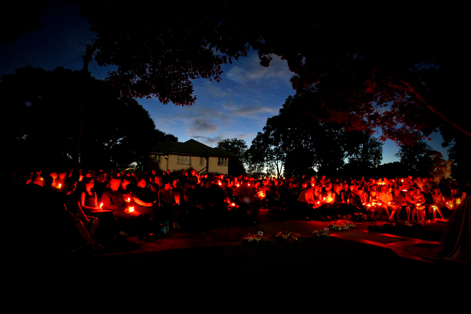 January 10, 2012. Residents of Grantham hold candles as they quietly pay their respects during the dawn memorial service at Grantham, Australia. January marks one year since flash flooding tore through the communities of Toowoomba and the Lockyer Valley killing 35 people when more than 70 percent of the state of Queensland was flooded.