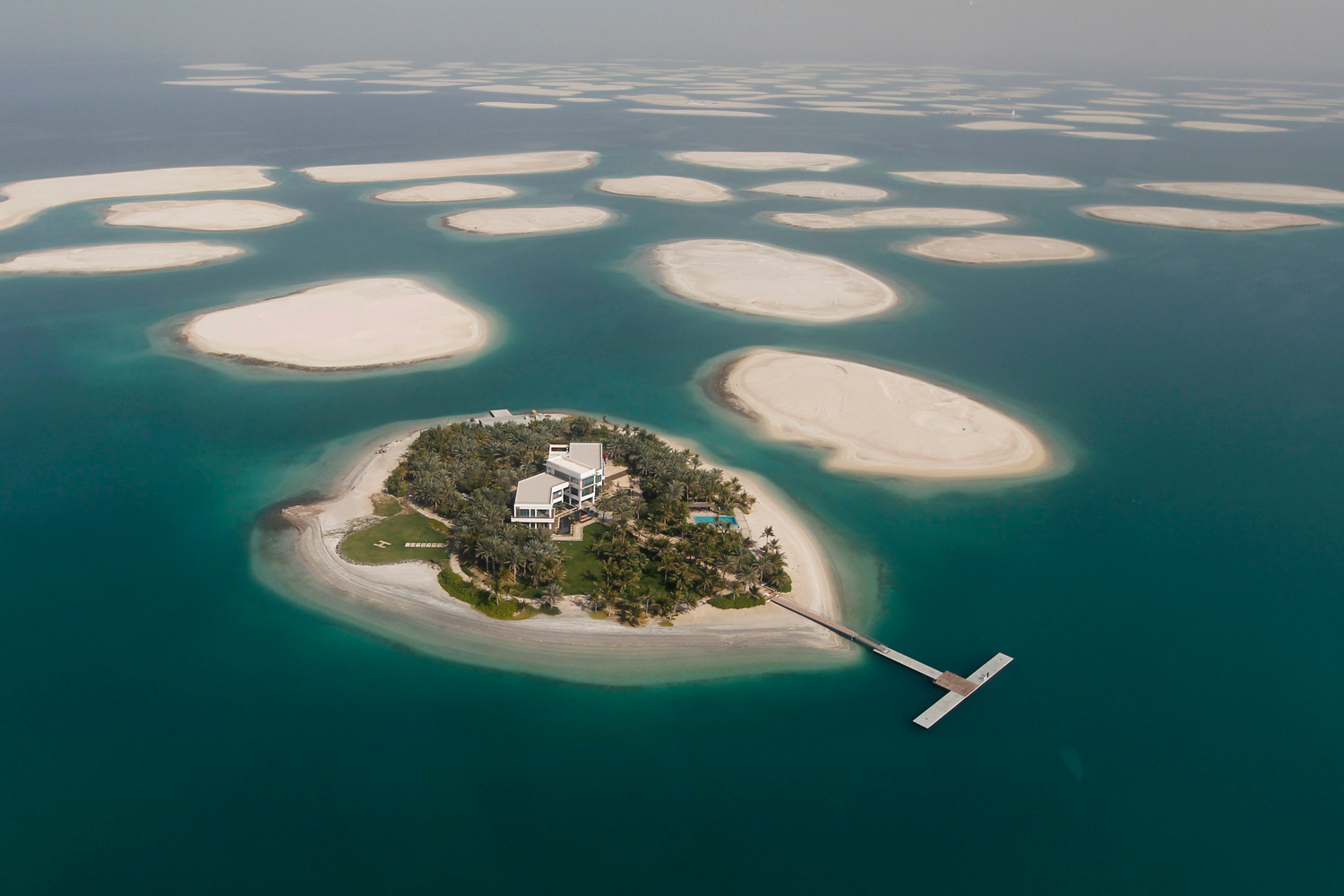 January 7, 2012. A development is seen on one of the islands of The World Islands project in Dubai. The World Islands is located approximately 4 km (2.5 miles) off the coast of Jumeirah. The collection of man-made islands are shaped into the continents of the world, and will consist of 300 small private artificial islands divided into four categories: private homes, estate homes, dream resorts, and community islands, according to the development company Nakheel Properties Group.