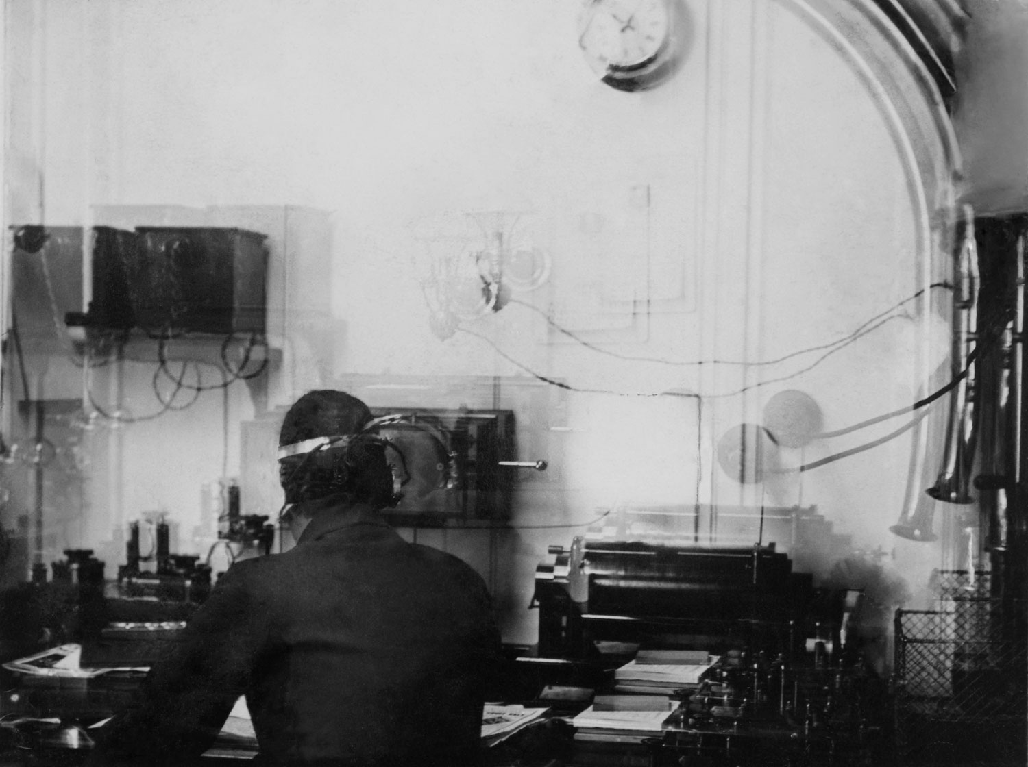Wireless operator Harold Bride at work in the Marconi Room on the Titanic, 1912.