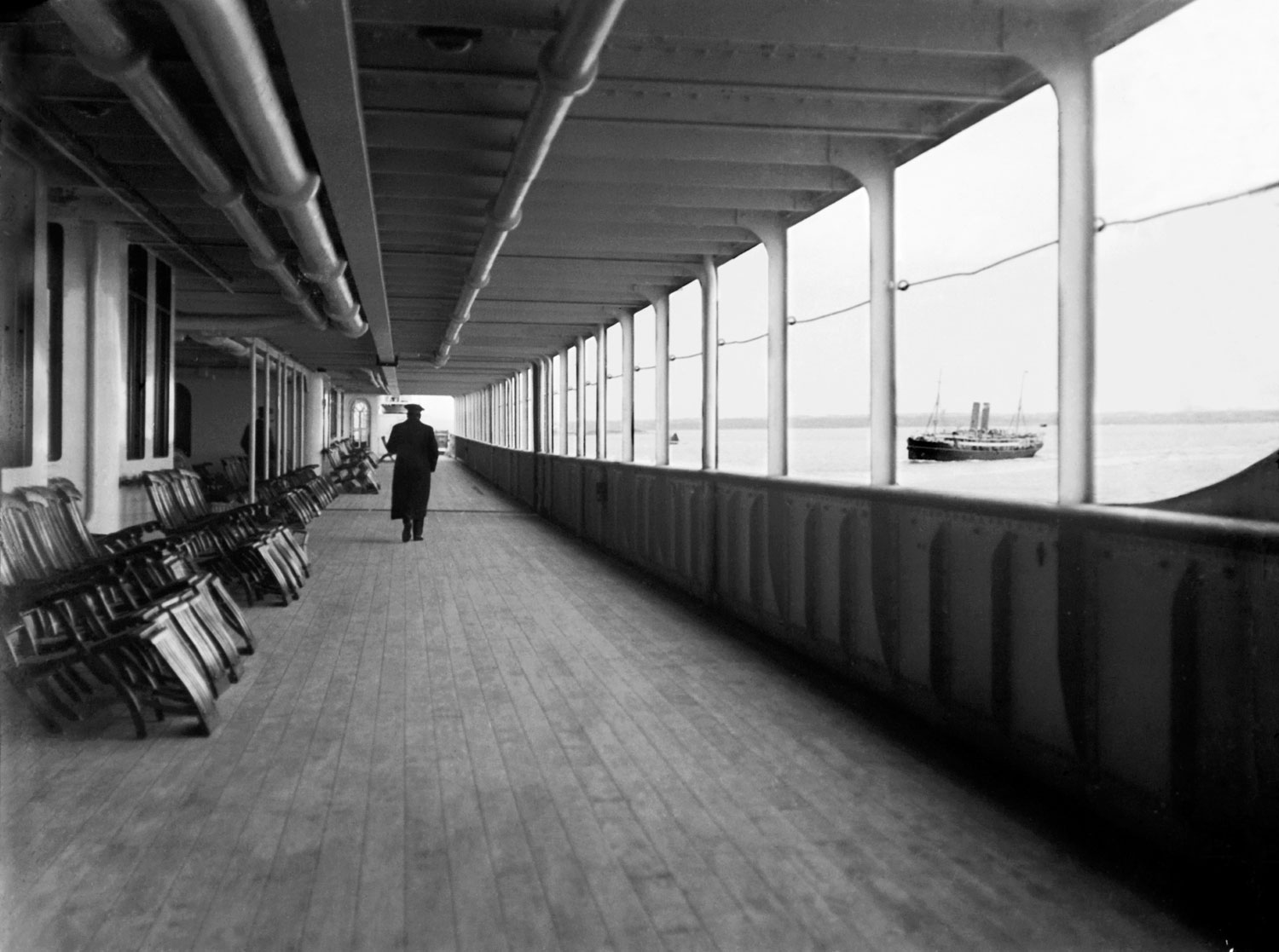 Promenade deck of the Titanic, after leaving Southampton and passing the Portuguese RMSP Tagus, 1912.