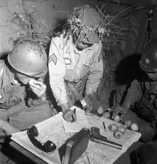 South Korean and American officers pore over maps in a 1952 Margaret Bourke-White photo.