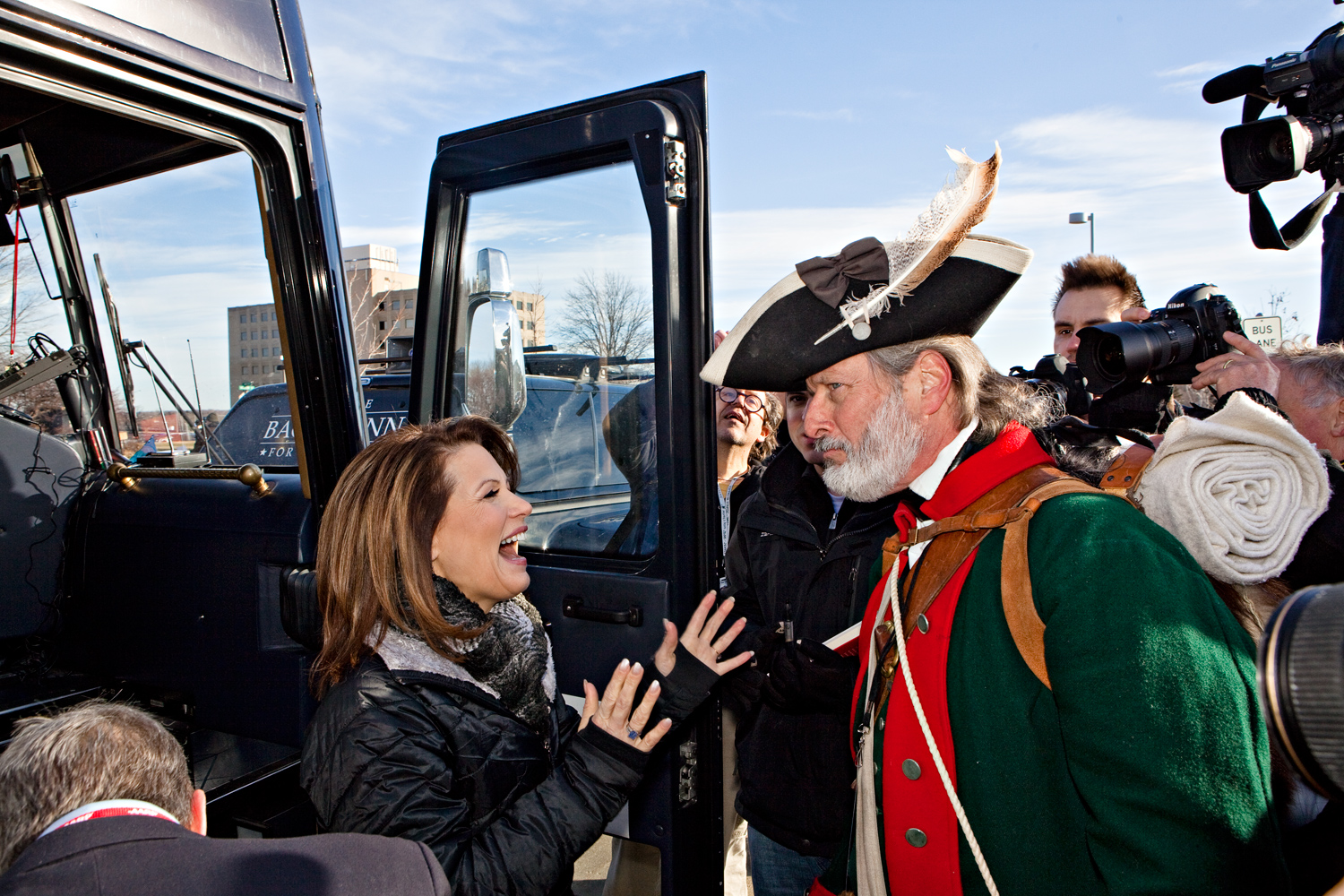 William Temple, a Revolutionary War reenactor, who has become an unofficial tea party mascot, greets Michele Bachmann at a campaign stop called 'Rock the Caucus,' at Valley High School in West Des Moines, Iowa on January 3, 2012.
