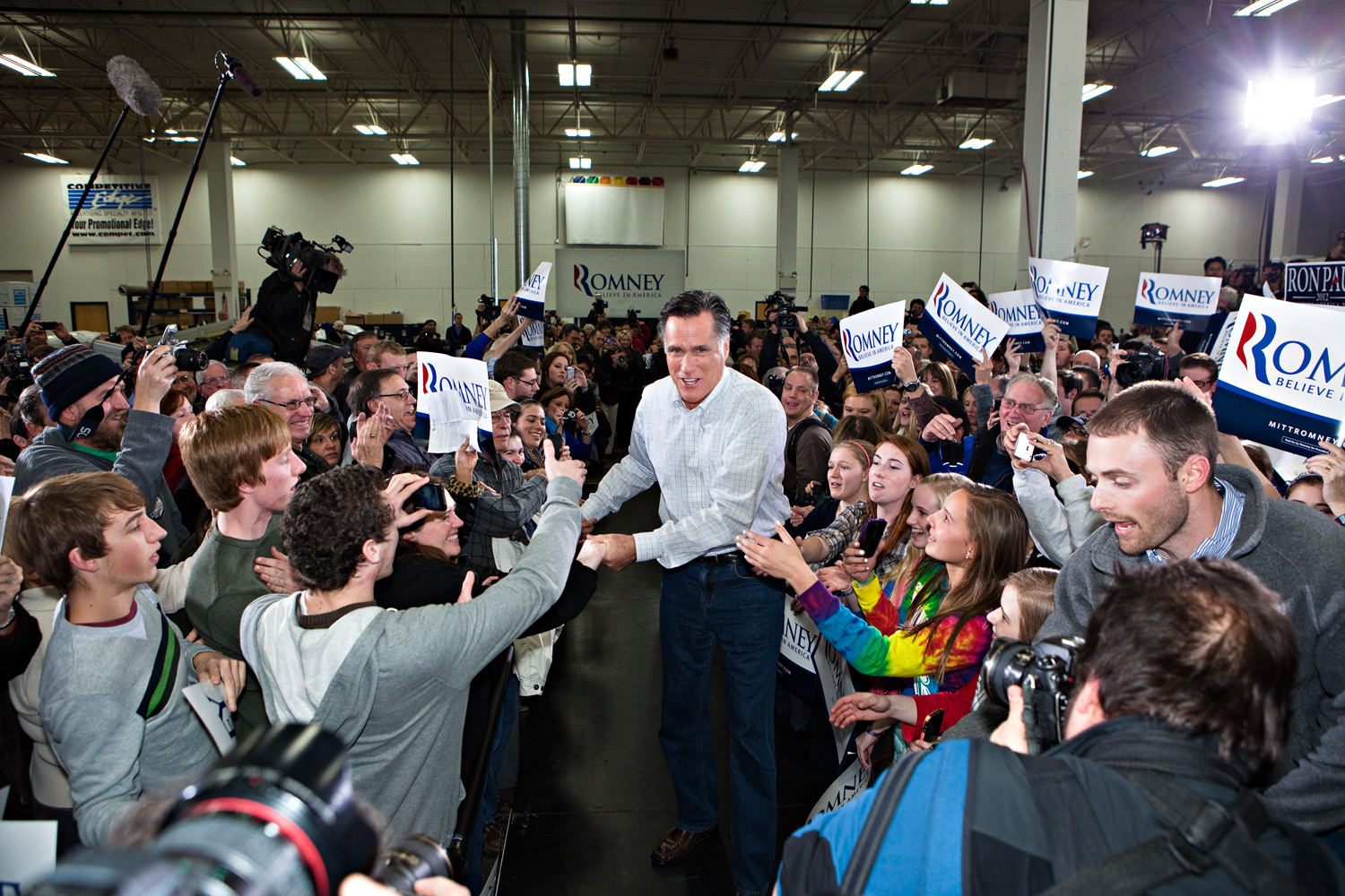 Mitt Romney greets crowds of campaign supporters at Competitive Edge in Clive, Iowa the day before the caucus on January 2, 2012.