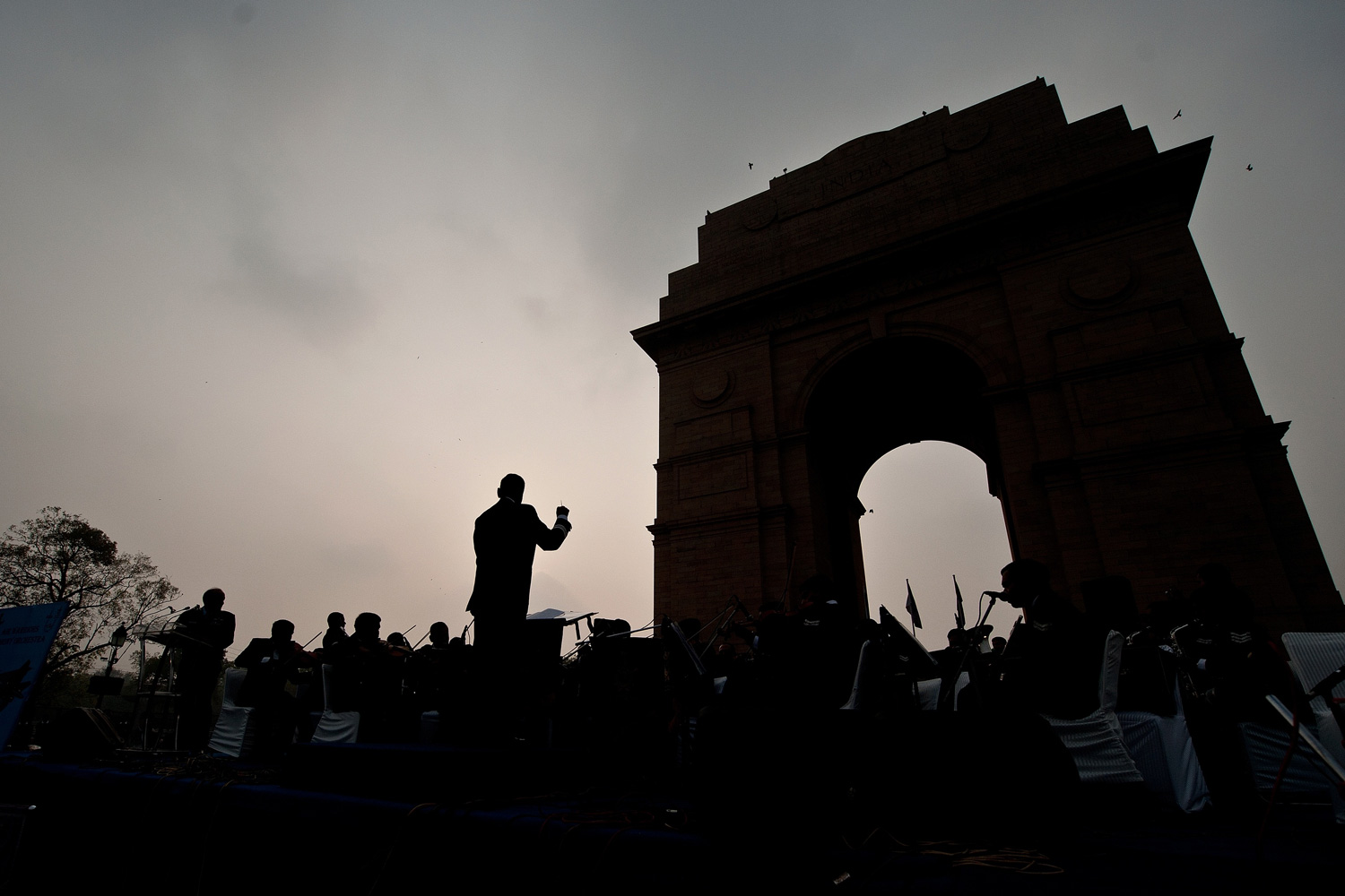 January 7, 2012. Indian Air Force Band members are silhouetted as they perform for the public at the India Gate in New Delhi.