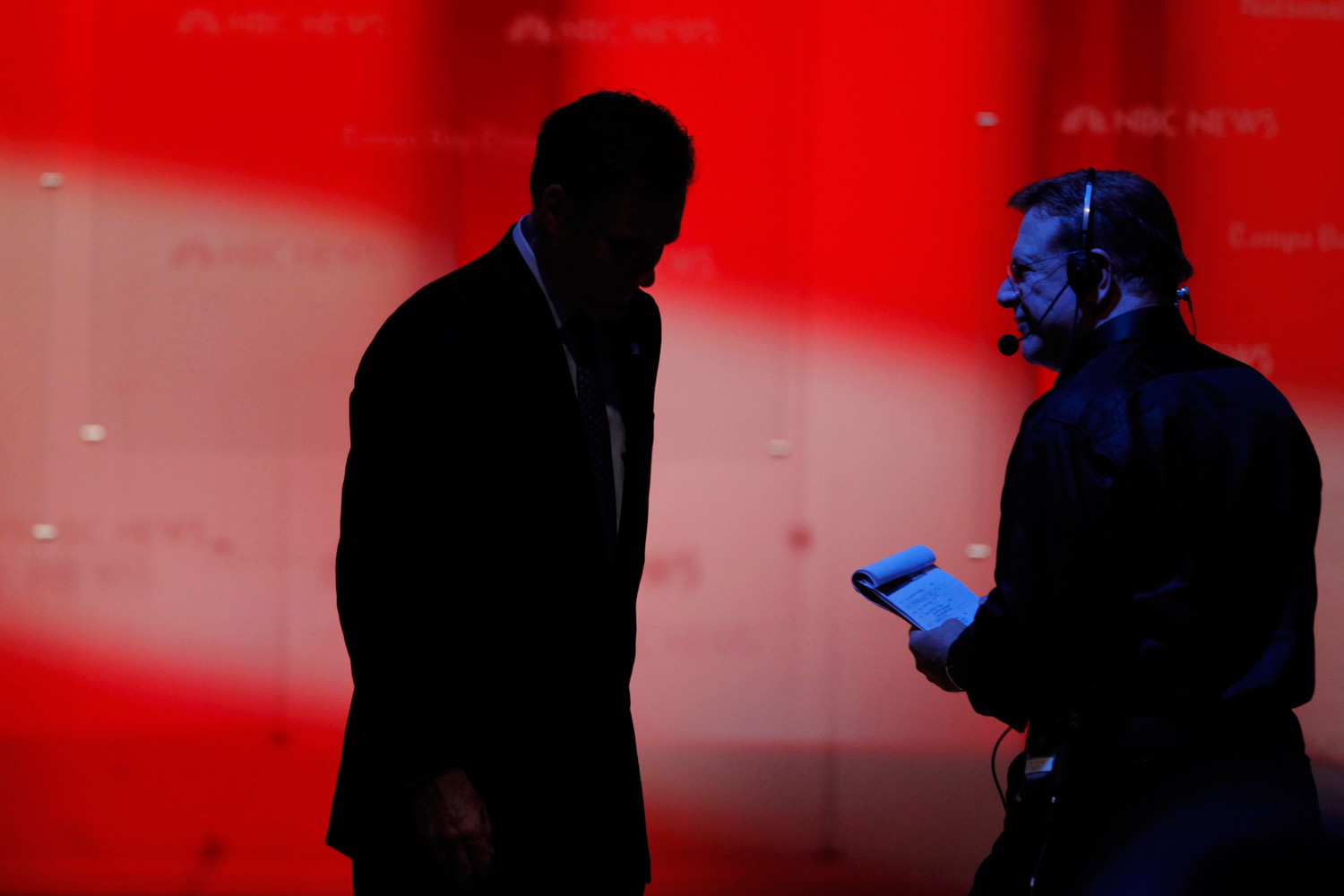 January 23, 2012. Republican presidential candidate and former Massachusetts Governor Mitt Romney (L) is silhouetted as he walks off stage following the Republican presidential candidates debate in Tampa, Fla.