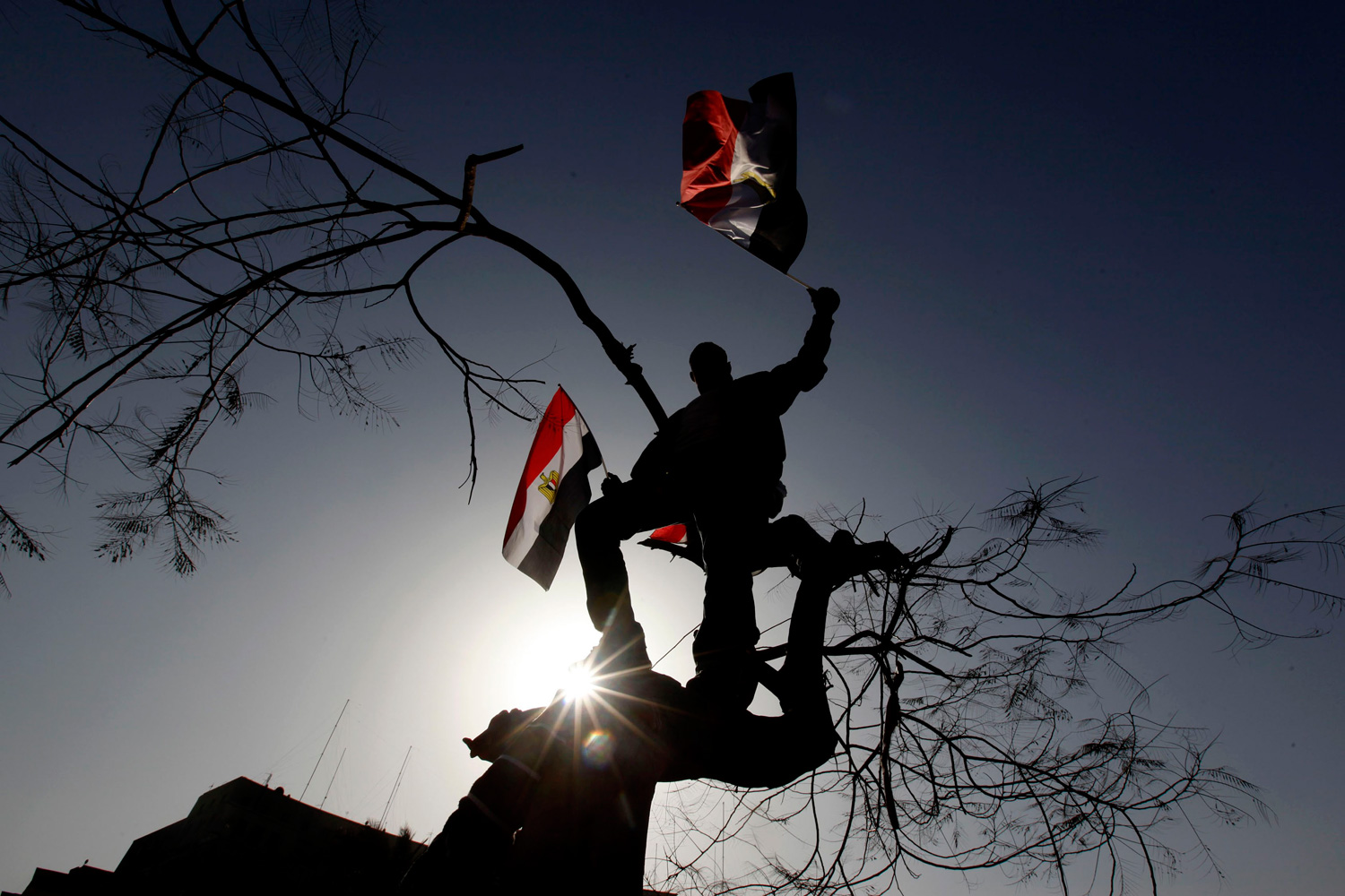 January 25, 2012. A demonstrator waves an Egyptian flag during a protest marking the first anniversary of Egypt's uprising at Tahrir square in Cairo.