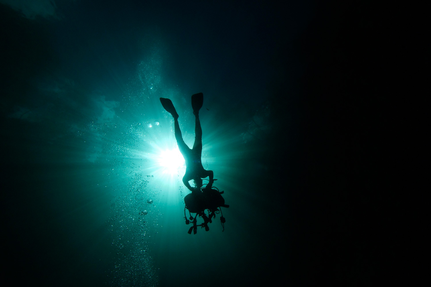 January 24, 2012. A scuba diver removes his equipment as he prepares to exit La Cueva de los Peces (Cave of the Fish) along the coast of Playa Giron, near the Bay of Pigs, 160 km (100 miles) south-east of Havana, in central Cuba.