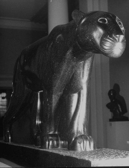 A sculpture of a cat figure walking is seen at the Metropolitan Museum of Art
