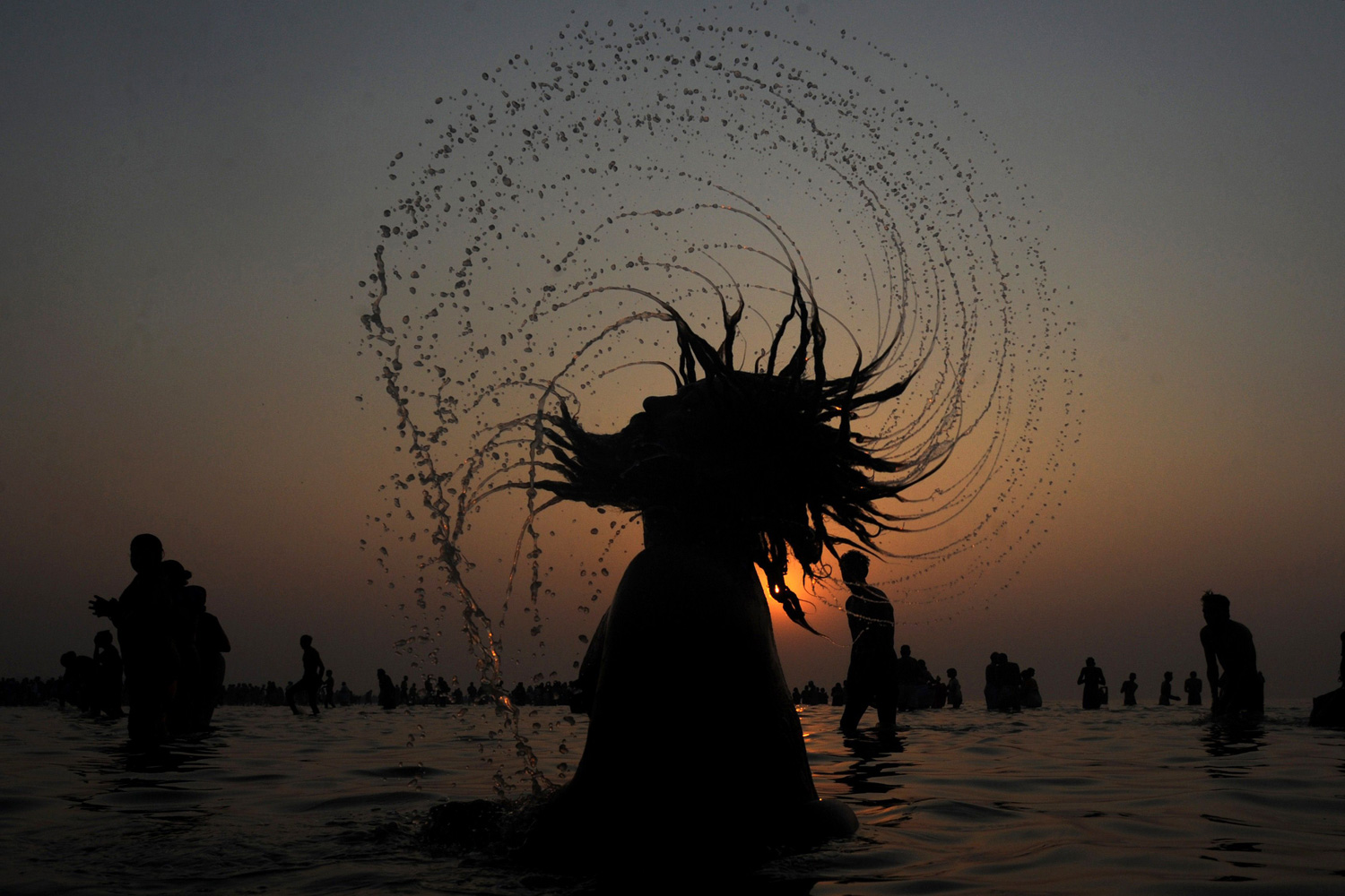 January 15, 2012. An Indian Sadhu (Hindu holy man) takes a dip in the sea at Gangasagar, about 155 kms south of Kolkata. Some four hundred thousand Hindu pilgrims gathered at the Gangasagar Mela (Fair) to take a dip in the ocean at the confluence of the River Ganges and the Bay of Bengal, on the occasion of Makar Sankranti, a holy day of the Hindu calendar considered to be of great religious significance in Hindu mythology.
