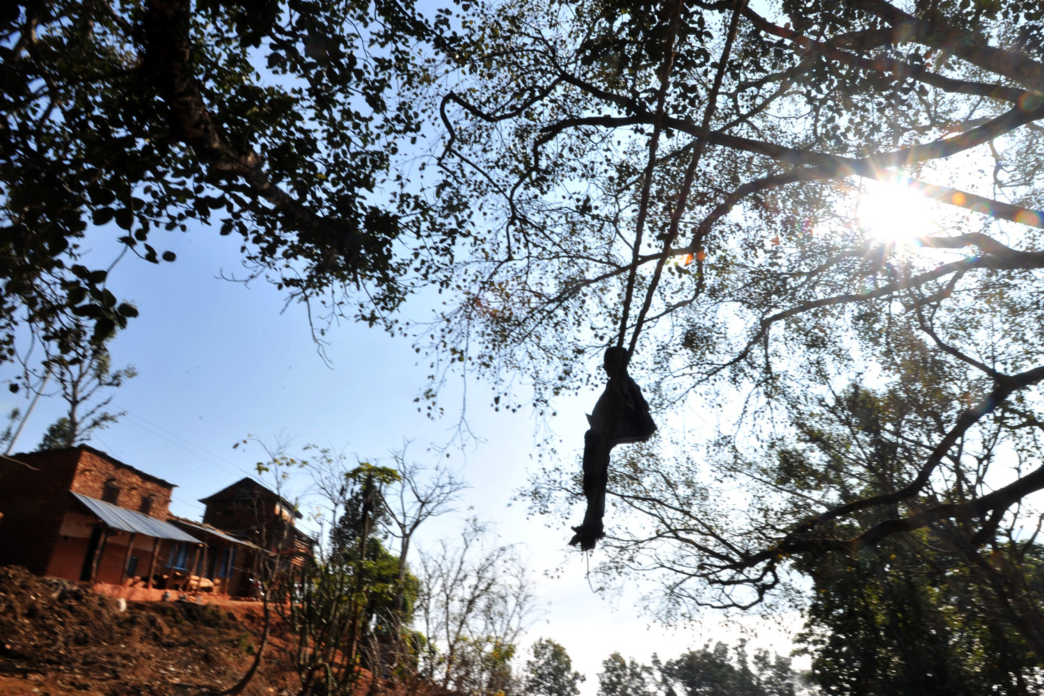 January 15, 2012. A young Nepalese plays on a swing during the Hindu festival of Maghesangranti at Taraka village, Nuwakot district, some 80 kilometers from Kathmandu.