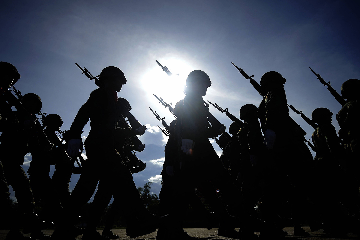 January 18, 2012. Thai soldiers march in a parade as part of celebrations of the Royal Thai Army national day at a navy base in Thailand's restive southern province of Narathiwat.