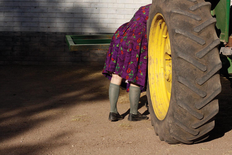 Elizabeth fixing a tractor. Nuevo Ideal, Durango, Mexico, 2010