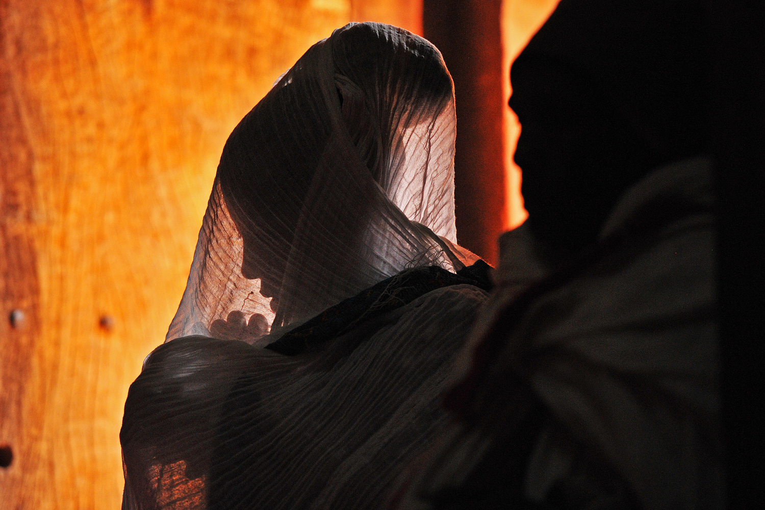 January 19, 2012. An Ethiopian Orthodox Christian pilgrim is pictured at a mass before the annual festival of Timkat in Lalibela, Ethiopia, which celebrates the Baptism of Jesus in the Jordan River.