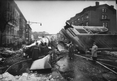 Wreckage litters the streets of Brooklyn after two airliners collide above the borough, December 1960.
