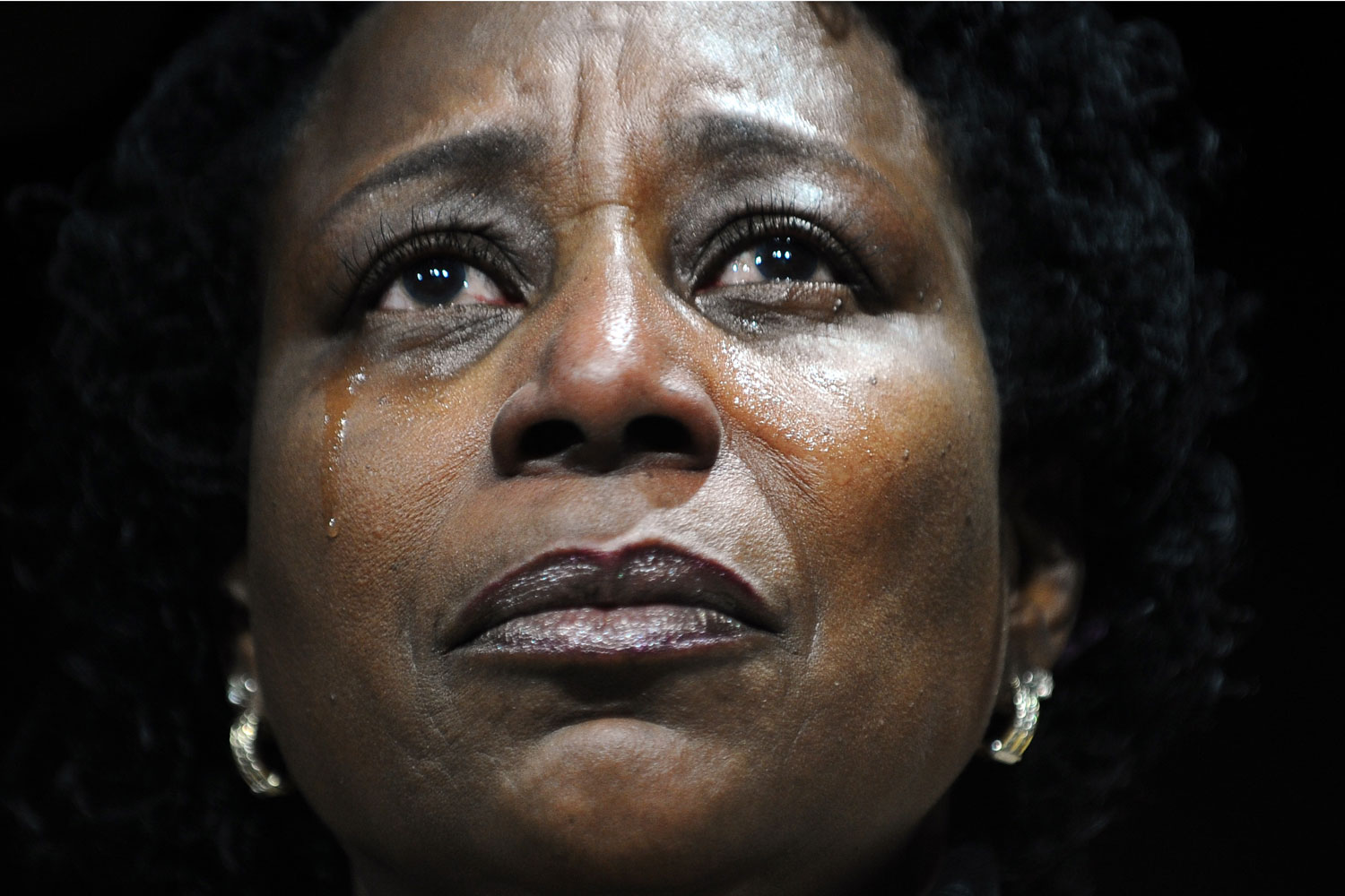 January 11, 2012. A supporter cries as she listens to US President Barack Obama address a campaign event at the University of Illinois at Chicago in Chicago, Illinois.